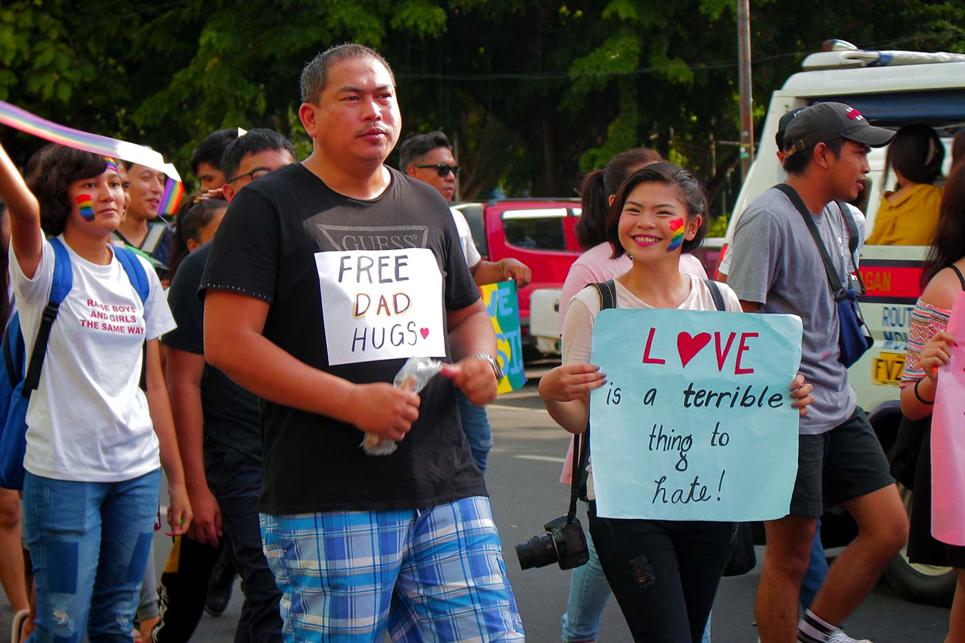 FATHERLY PRIDE. Clint Severino and daughter march side by side at Bacolod City's pride parade. Photo by Nichol Francis Anduyan