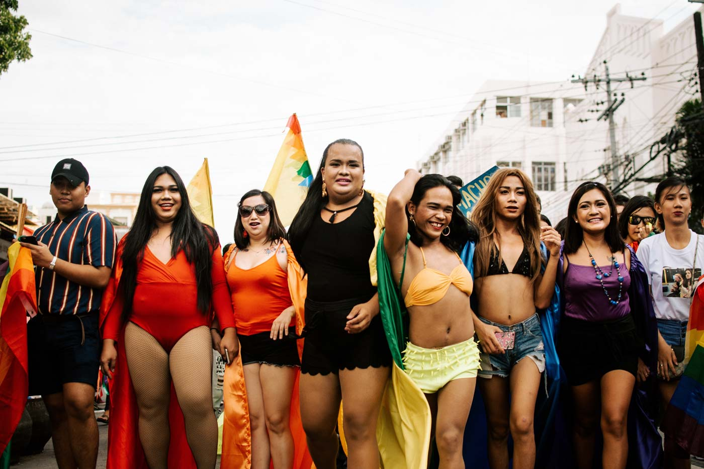 HUMAN RAINBOW. Members of the LGBTQ+ form a human rainbow with their color-coordinated outfits. Photo by Jorge Gamboa