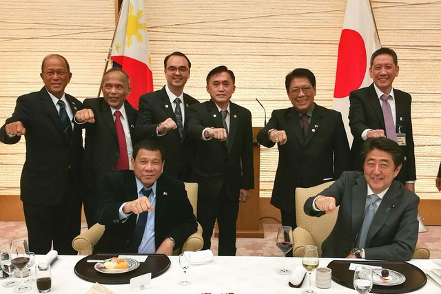 MORE LOANS, GRANTS. President Rodrigo Duterte and Japanese Prime Minister Shinzo Abe (seated) have their picture taken at a reception at the Prime Minister's Official Residence in Japan on October 26, 2016. Photo by Albert Alcain/Presidential Photo