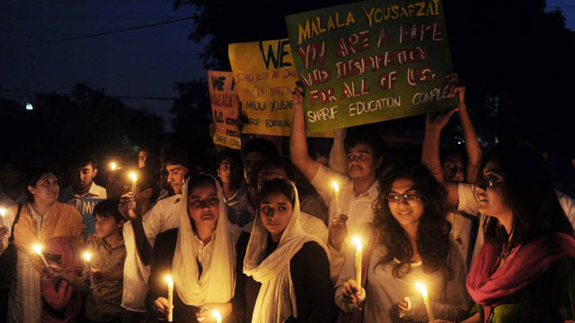 FOR MALALA. Pakistani civil society activists carry candles to pay tribute to gunshot victim Malala Yousafzai and protest against her assassination attempt, in Lahore on October 10, 2012. AFP PHOTO/ Arif Ali