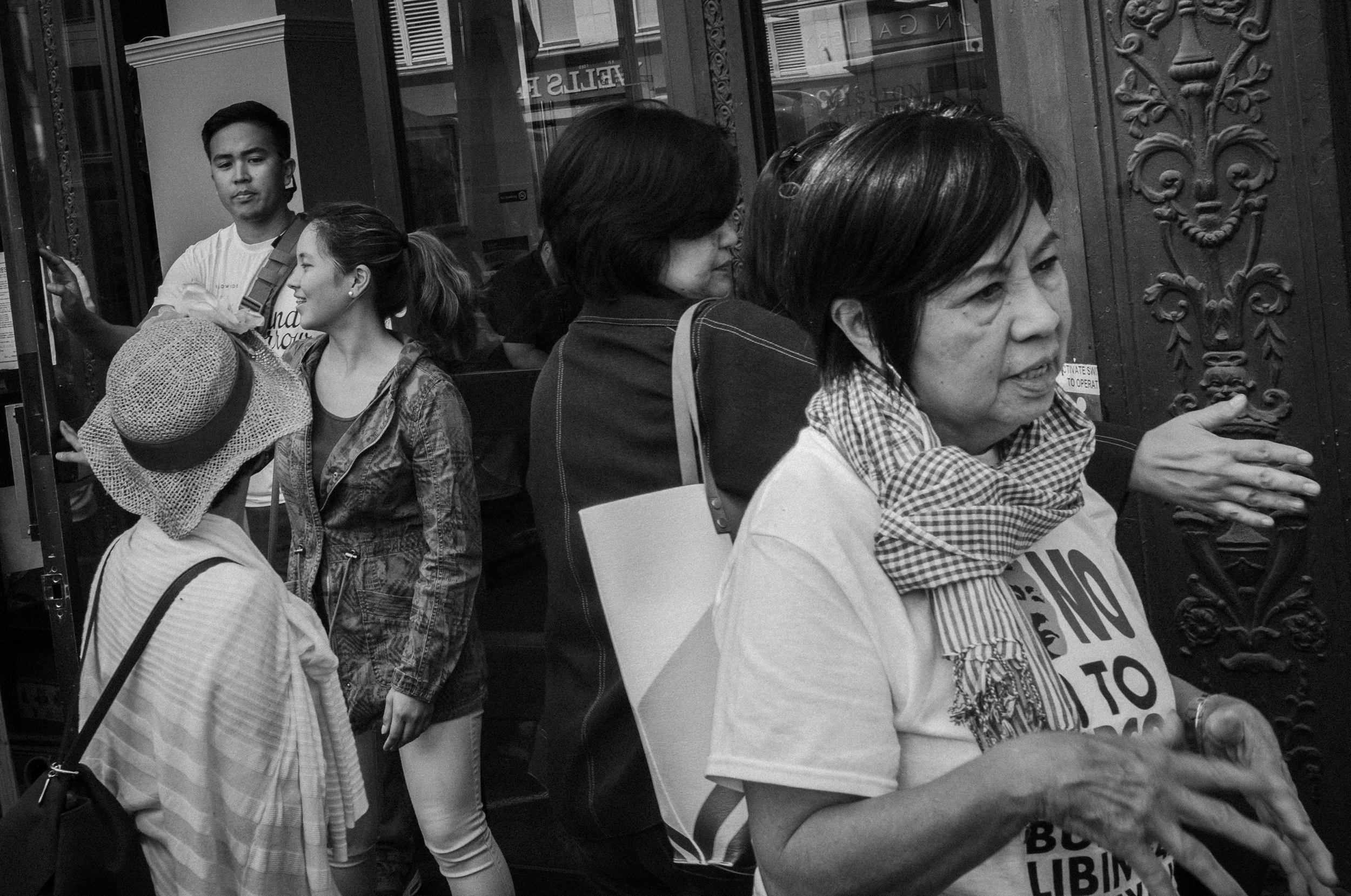 WOMEN VS MARCOS. Mila de Guzman, author of Women Against Marcos: Stories of Filipino and Filipino American Women who Fought a Dictator,€ at the demonstration. Photo by Rick Rocamora