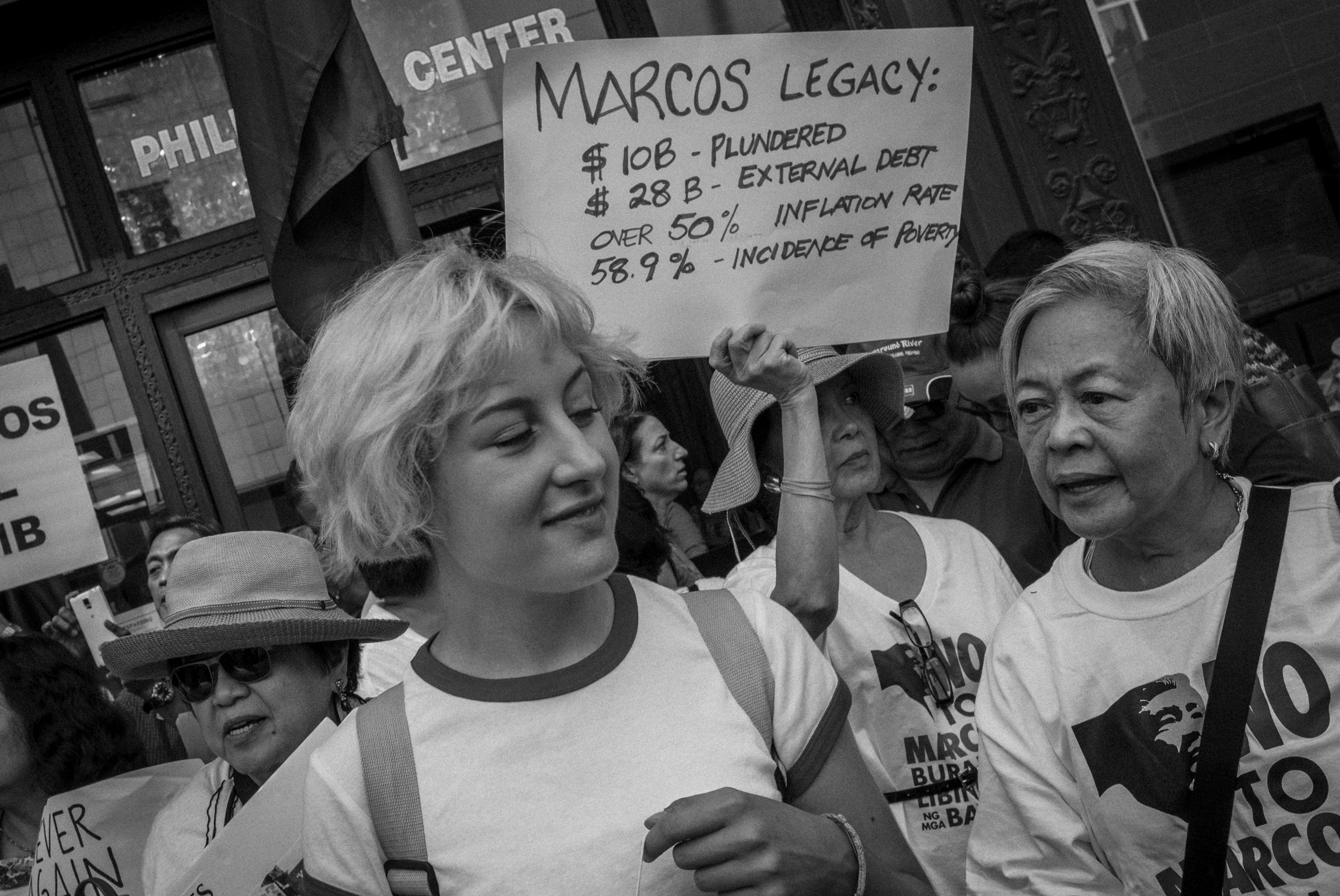 MOTHERS AND DAUGHTERS. Lorena (L), 17- year old daughter of Melinda Paras, who was named after Lorena Barrios, joined the protest together with Leni Marin and Thelma King. Photo by Rick Rocamora