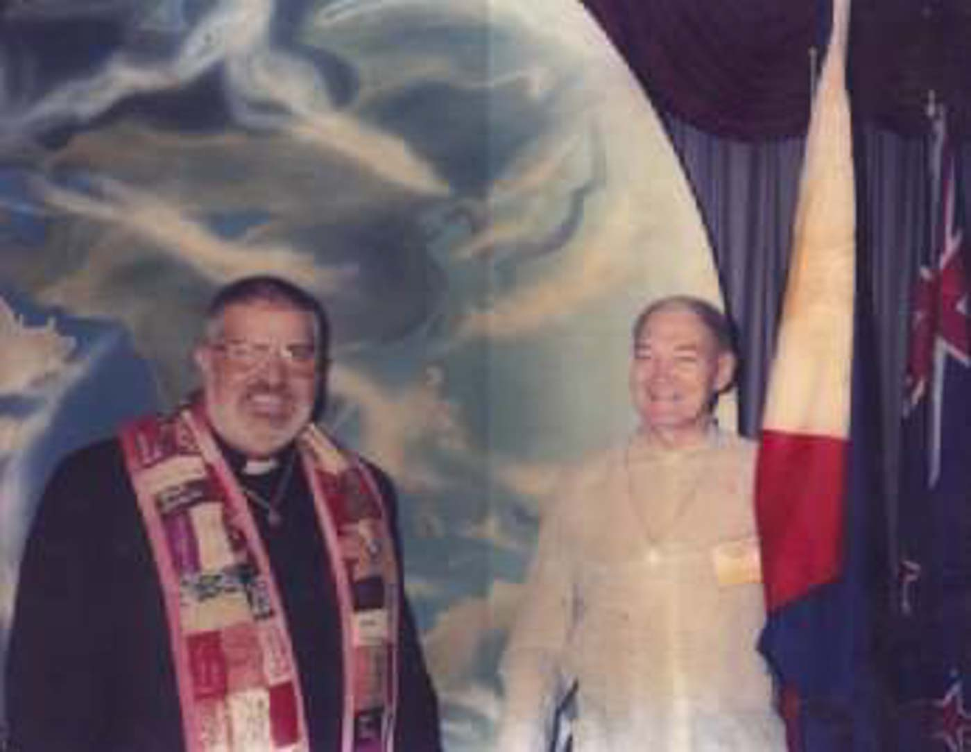 FOUNDING OF MCC MANILA. Father Richard Mickley (right) holding the flag of the Philippines with Reverend Troy Perry, founder of MCC worldwide. Photo courtesy of Father Richard Mickley