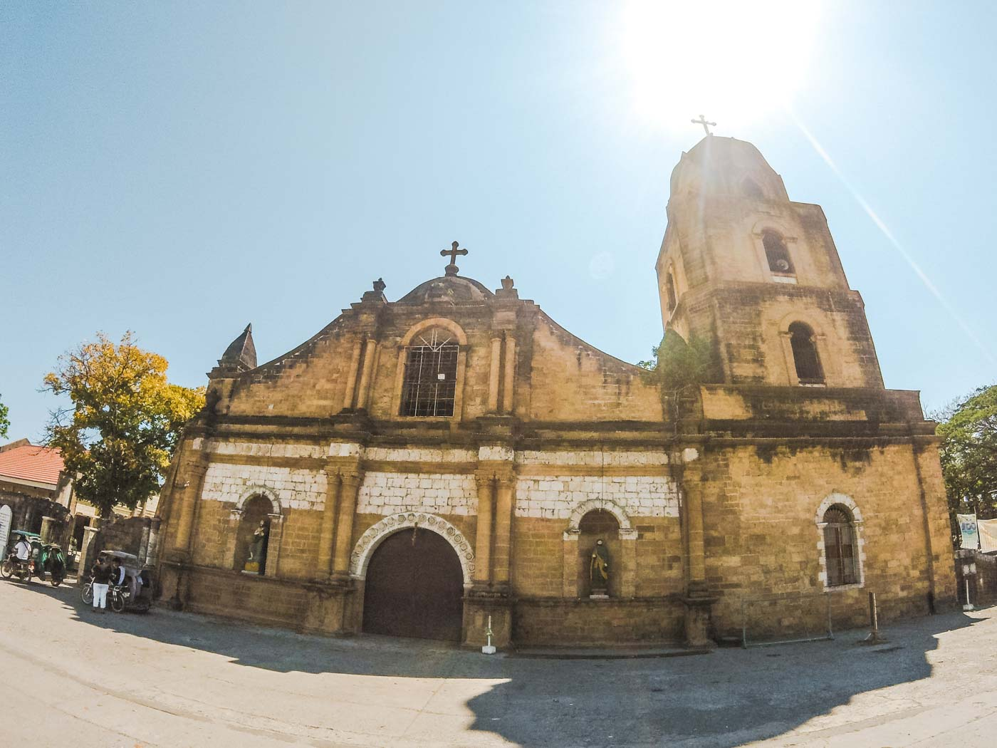 """CENTURIES-OLD. One of the oldest churches in the country that was built in the year 1769, the """"yellowish"""" Guimbal Church's walls are made from adobe, coral, and limestones. Photo by Carl Don Berwin/Rappler"""