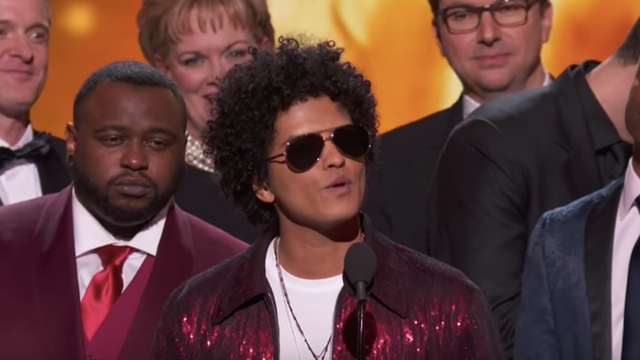 BRUNO MARS. The night's biggest winner shouts out to his fellow nominees as he accepts the award for Album of the Year. Screengrab from YouTube.com/recordingacademy