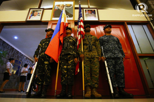 Flag bearers from the Philippine and the US await the entrance of colors during the opening ceremonies for the annual RP-US Balikatan at the AFP-COC inside Camp Aguinaldo in Quezon City on April 4, 2016. Ben Nabong/Rappler