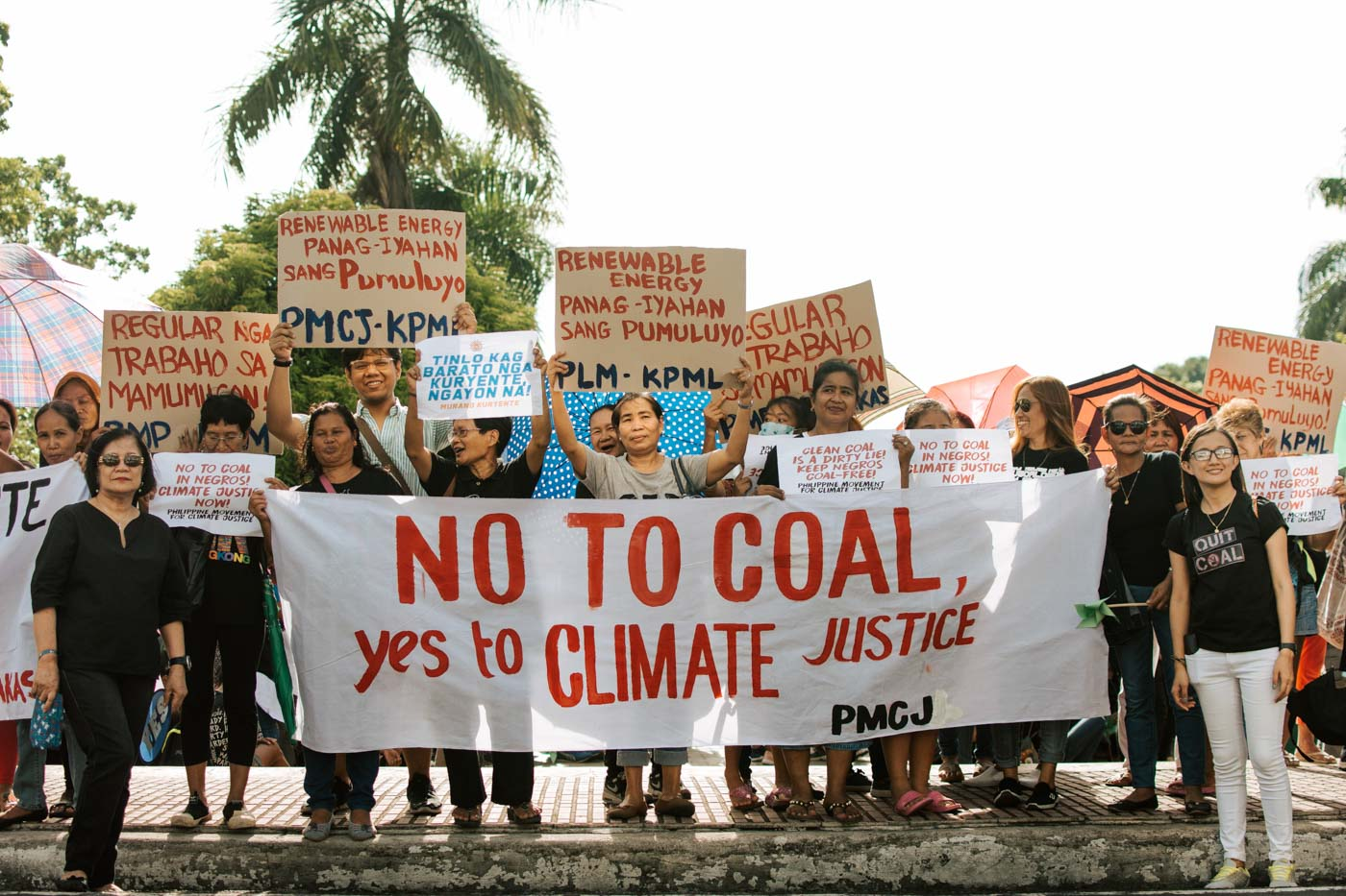 FIGHT CONTINUES. Activists from the Philippine Movement for Climate Justice join the inaugural protest to continue fight for a coal-free Negros at the Provincial Capitol in Bacolod City on Saturday, June 29. Photo by Jorge Gamboa