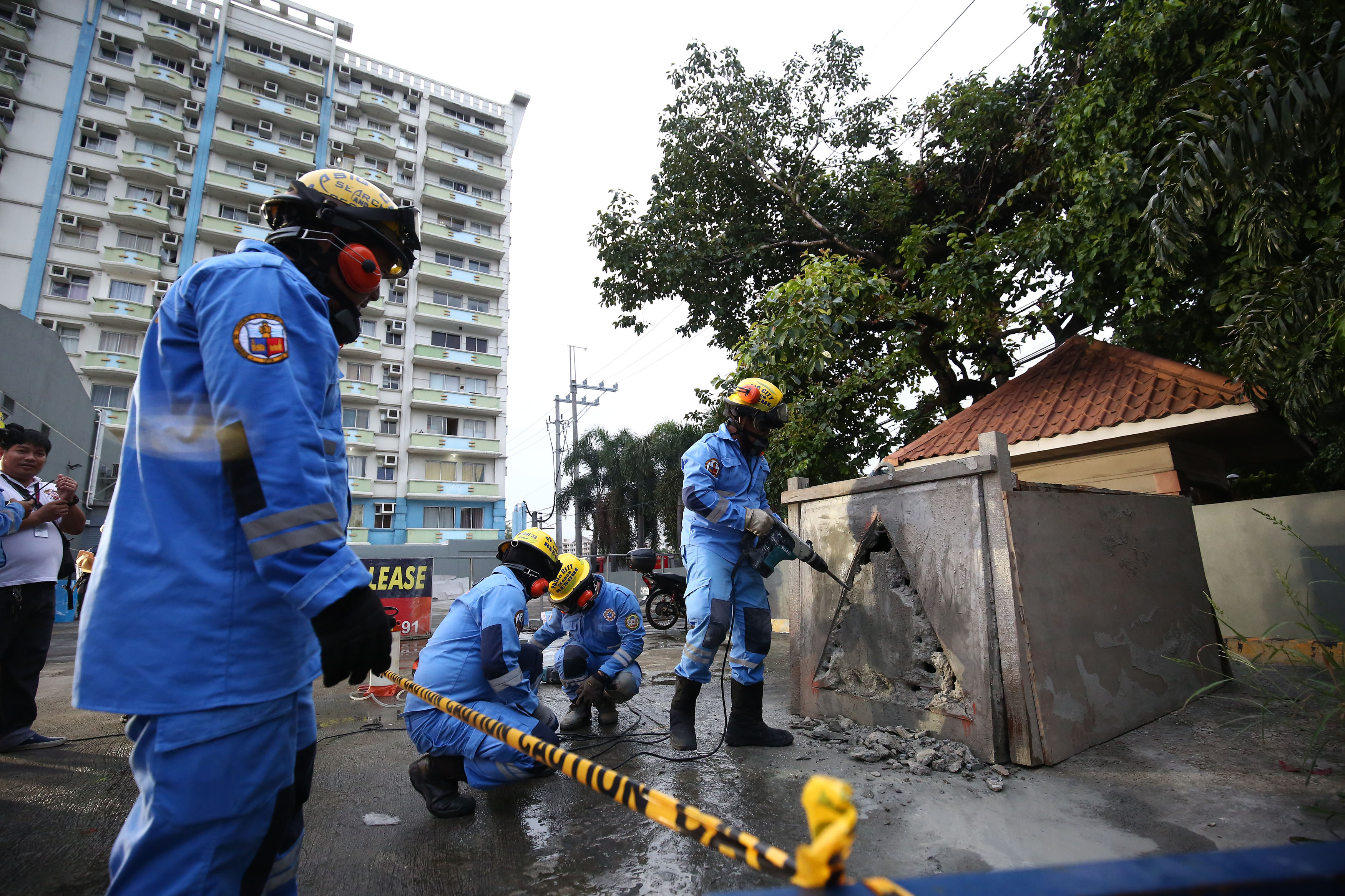 "Rescue personnel respond and apply first aid to mock victims at the various scenario in case ""the Big One"" strikes Metro Manila during the 5th Metro Manila Shake Drill in Pasig City on Saturday, July 27. Photo by Ben Nabong"