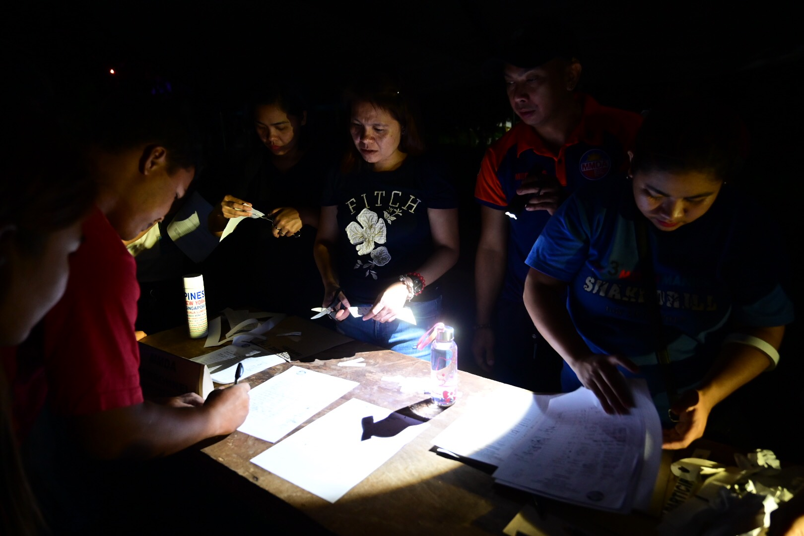 FLASHLIGHT. Responders for #MMShakeDrill struggle with dark as they simulate a strong earthquake that hit pre-daw. Photo by Alecs Ongcal/Rappler