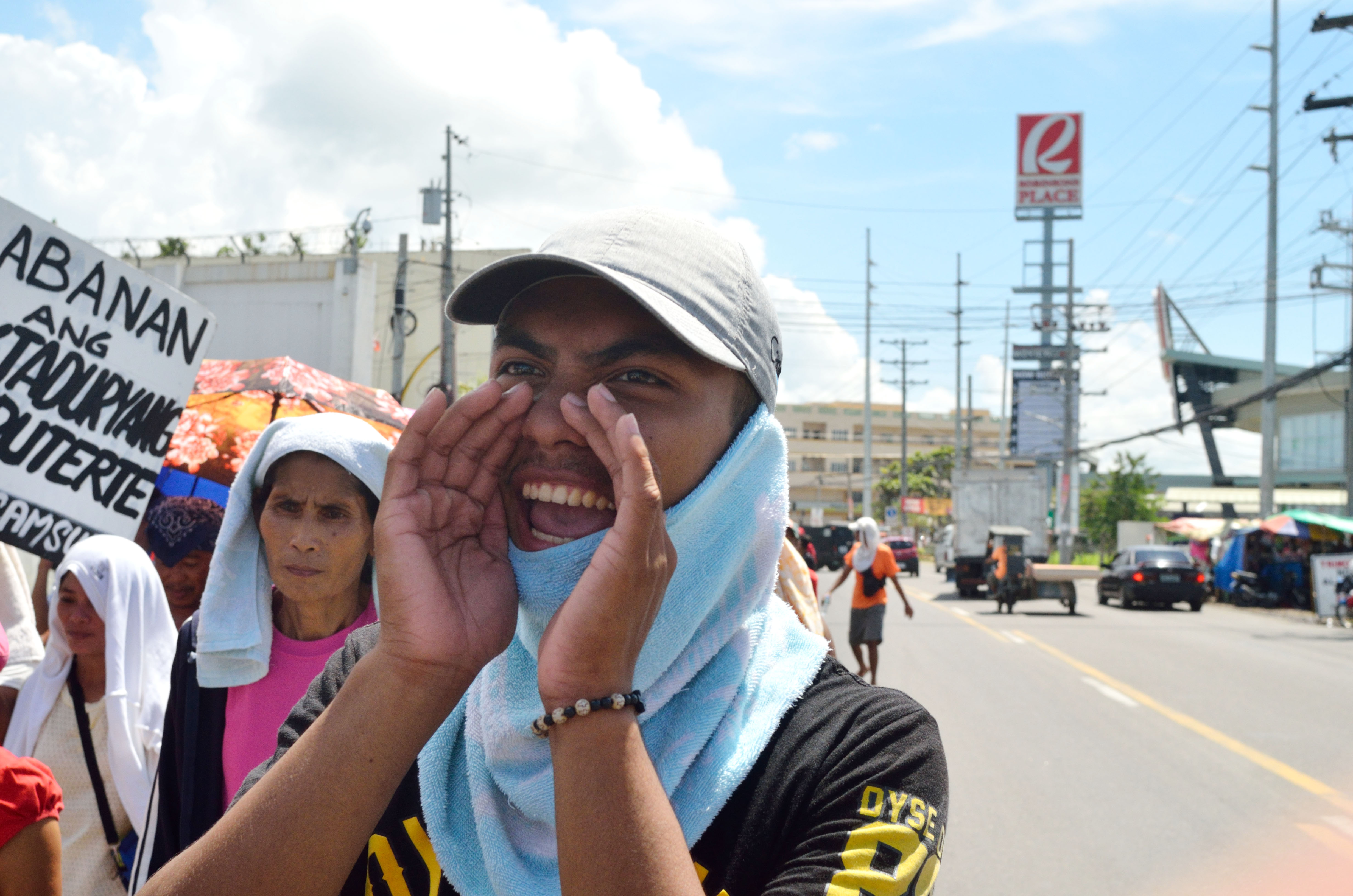 FIGHT DICTATORSHIP. Alex Guerro of the League of Filipino Students lead the chants during the protest. Photo by Miguel Imperial/Rappler