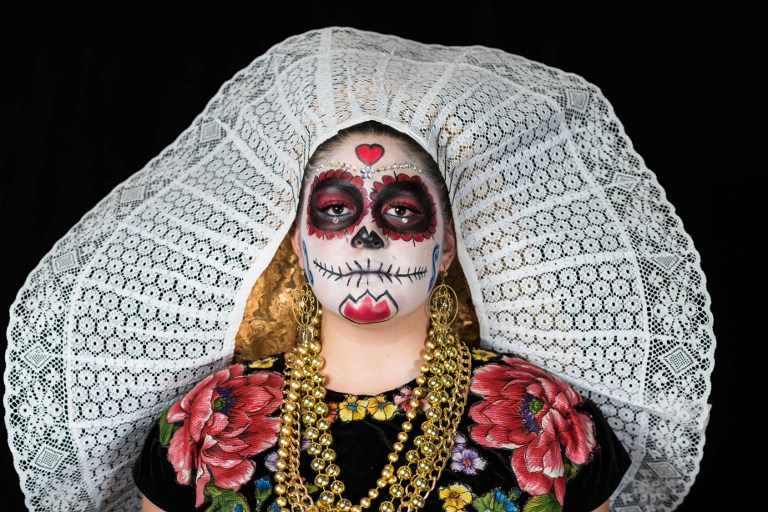 """DAY OF THE DEAD. Mexicans get ready to celebrate the Day of the Dead highlighting the character of La Catrina which was created by cartoonist Jose Guadalupe Posada, famous for his drawings of typical local, folkloric scenes, socio-political criticism and for his illustrations of """"skeletons"""" or skulls, including La Catrina. File Photo by Omar Torres/AFP"""