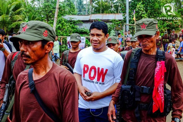 FREED. Senior Police Officer 4 Renie Rombo arrives at the Banglay Basketball court escorted by the New People's Army -Custodial force on Monday, May 2, 2016 after being held for 29 days as prisoner of war by the rebels. Photo by Bobby Lagsa/Rappler