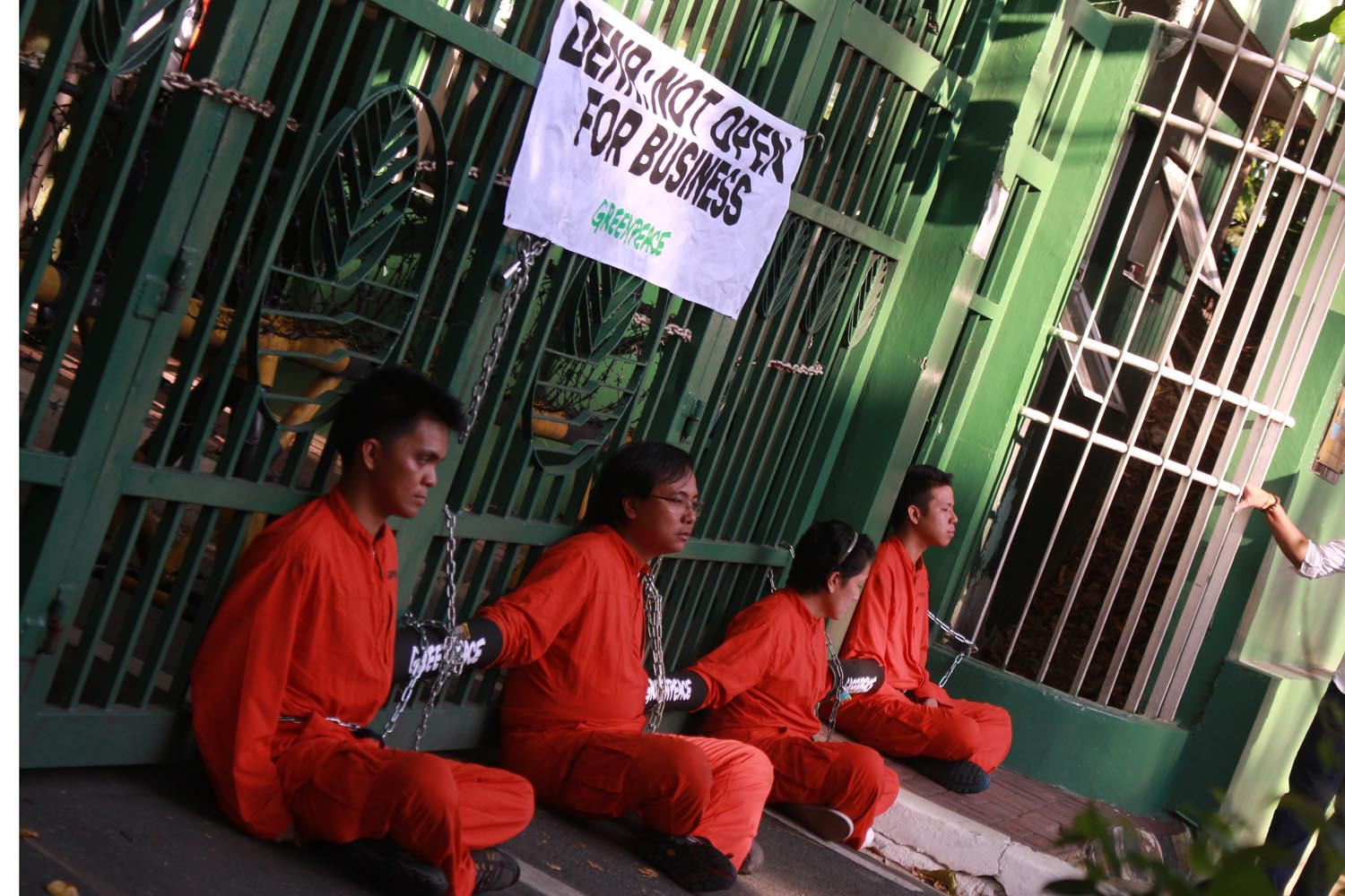 NOT OPEN. ActivistS from Greenpeace Philippines protest at the gates of the Department of Environment and Natural Resources office in Quezon City. Photo by: DARREN LANGIT/RAPPLER