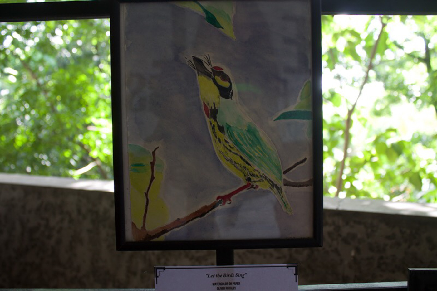 'LET THE BIRDS SING.' A painting made by a political prisoner is displayed at the Commission on Human Rights. All photos by Justin Francia/Rappler