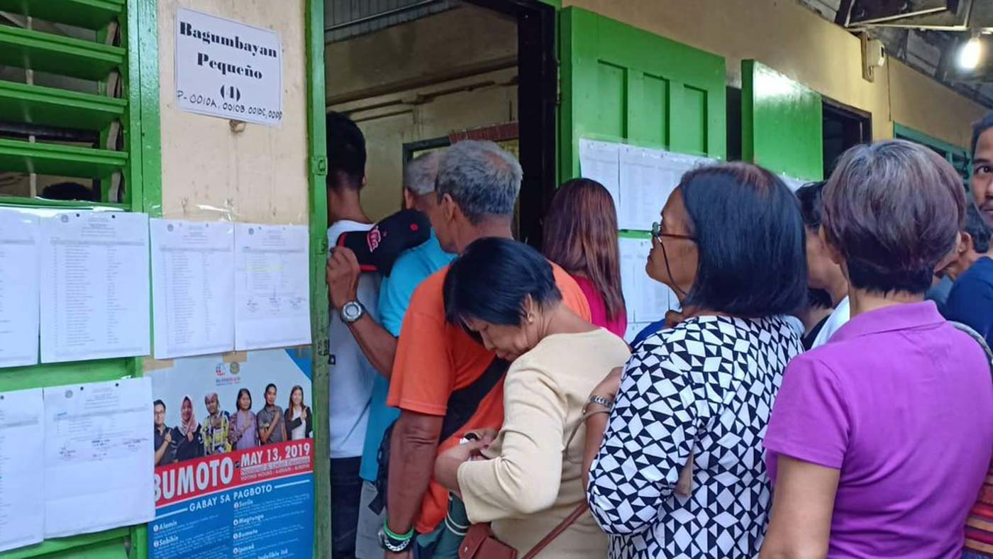 CAMARINES SUR. With the assistance of poll watchers, senior citizens and PWDs are given priority in queuing at the voting precincts of Goa Central School, Goa, Camarines Sur. Photo by Marc Villareal