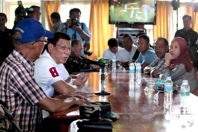 PRESIDENT IN BASILAN. President Rodrigo Duterte holds a meeting with local officials at the 104th Brigade Camp in Isabela City, Basilan on July 21. Photo by Robinson Ninal/PPD