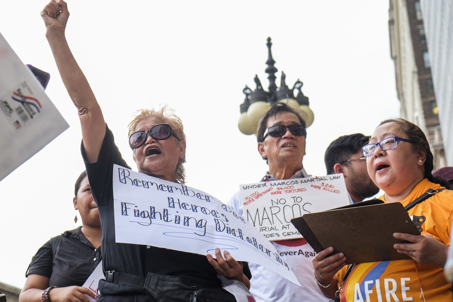 ACTIVISM CONTINUES. Filipinos in Chicago urge Philippine President Rodrigo Duterte to honor 'true heroes worthy of emulation' by not giving Ferdinand Marcos a hero's burial. Photo by Pat Nabong