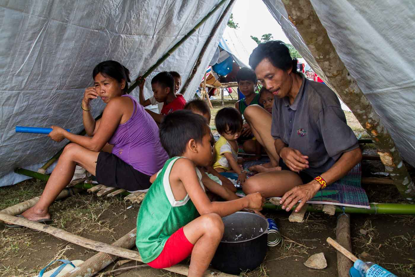 COPING. A Lumad family displaced by the conflict in Andap Valley has to wait for food provided by different aid groups and the DSWD. The Lumad are used to farming in high lands and getting their food from their own crops.