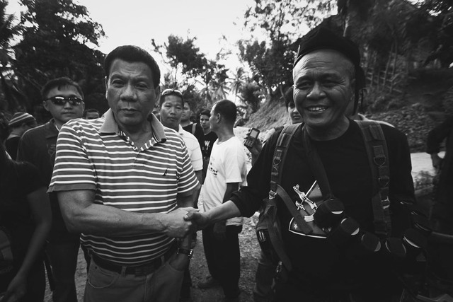 'MOST WANTED' NPA LEADER. In this file photo, 1st Pulang Bagani Battalion commander Leoncio 'Ka Parago' Pitao (R) is seen sharing a light moment with Davao City Mayor Rodrigo Duterte (L). File photo by Karlos Manlupig/Rappler