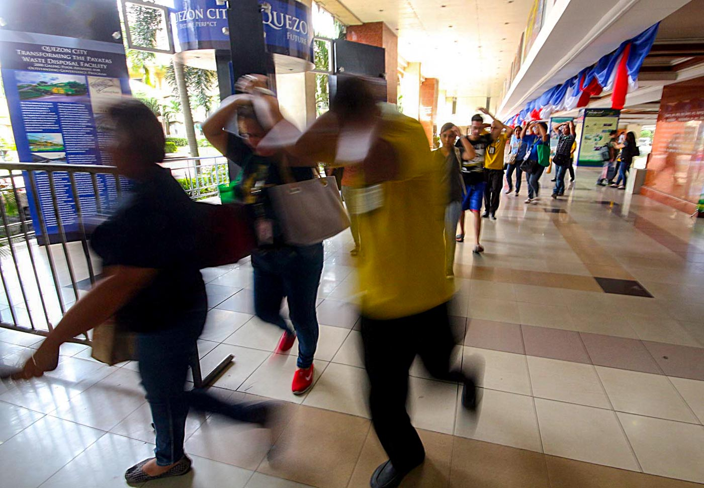 QUEZON CITY. Employees evacuate the building for the annual #MMShakeDrill. Photo by Darren Langit/Rappler