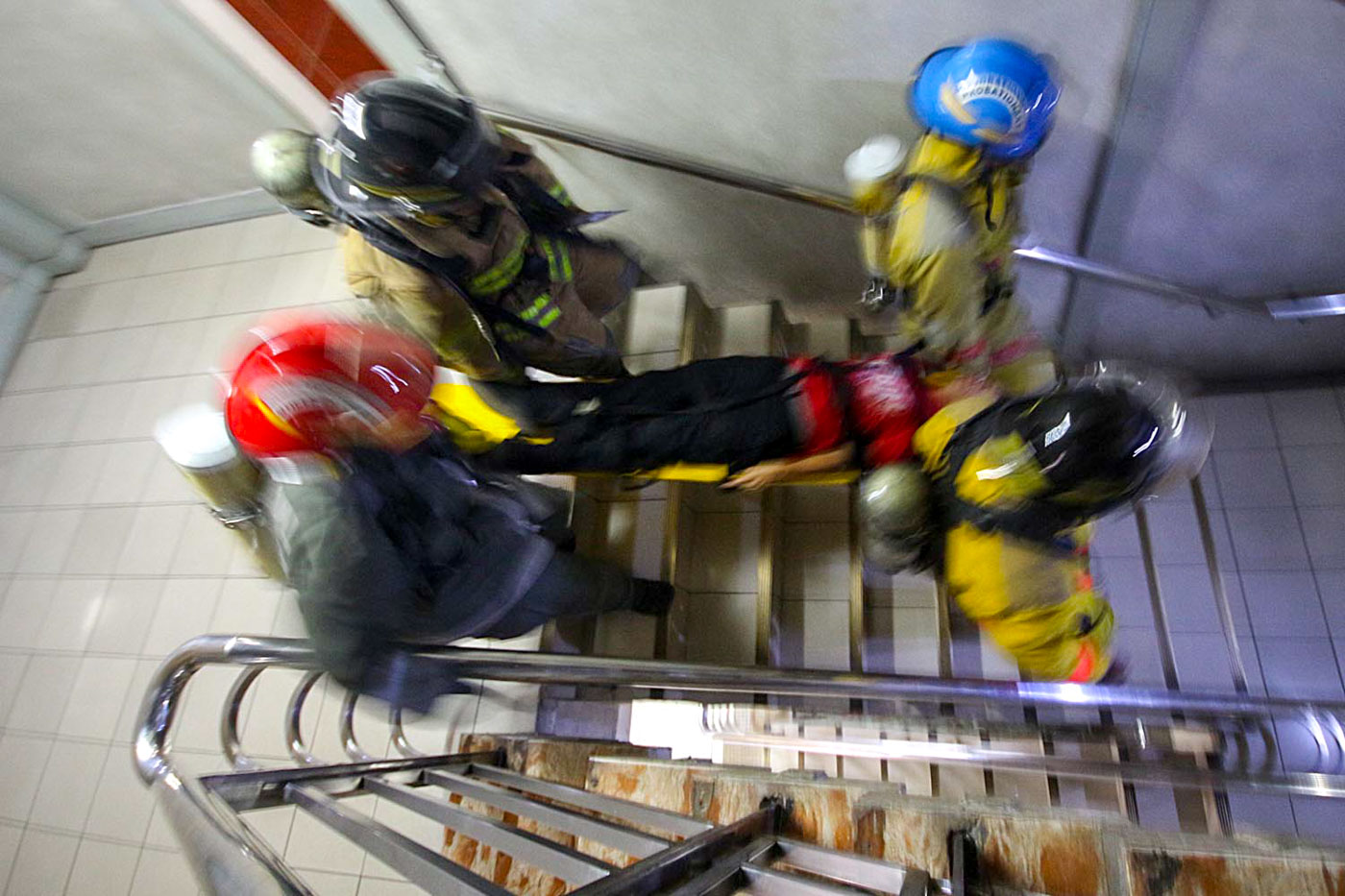 NORTH QUADRANT. Rescuers carry a victim on a stretcher out of the Quezon City Hall Building during the 3rd Metro Manila Shake Drill on Friday. Photo by Darren Langit/Rappler