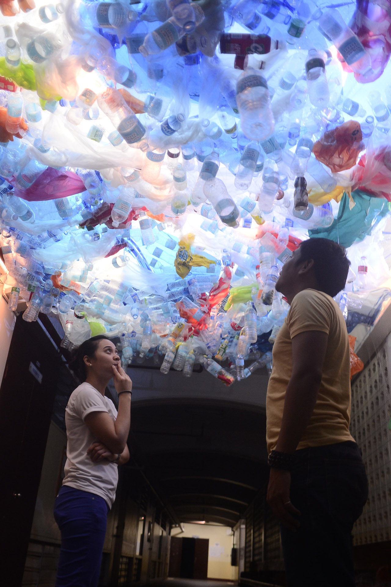 PERSPECTIVE. Plastic bottles, bags, and other single-use plastics hang from the XU Science Center's ceiling to simulate the suffocation of marine life. Photo from McKeough Marine Center