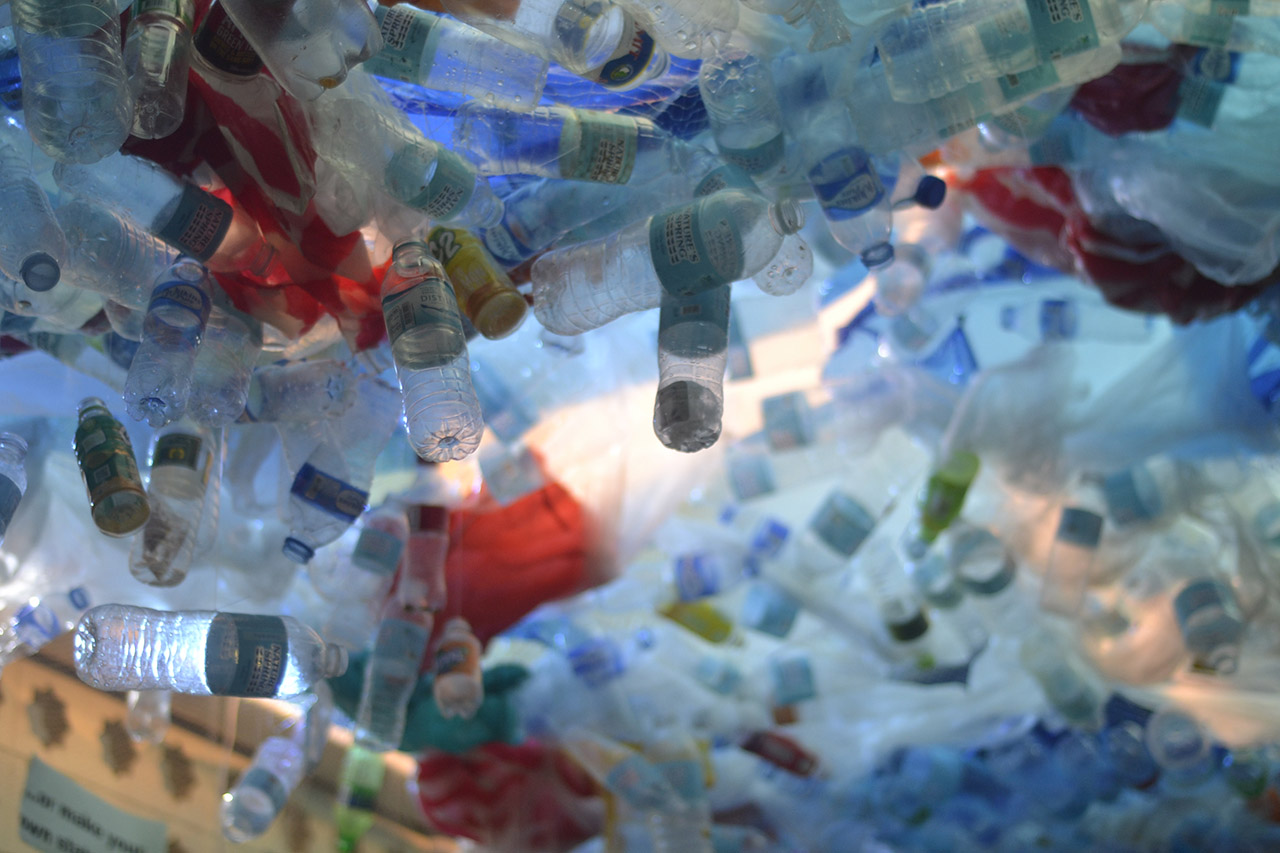 RECYCLED. Plastic bottles, sando bags, and other single-use plastics hang from the Science Center's ceiling to simulate the suffocation of marine life. Photo from McKeough Marine Center