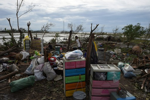 MAN VS NATURE. A man surveys the remains of his house after it was destroyed by super typhoon Haima in Cabagan town, Isabela province, north of Manila on October 20, 2016. Photo credits: Ted Aljibe/AFP