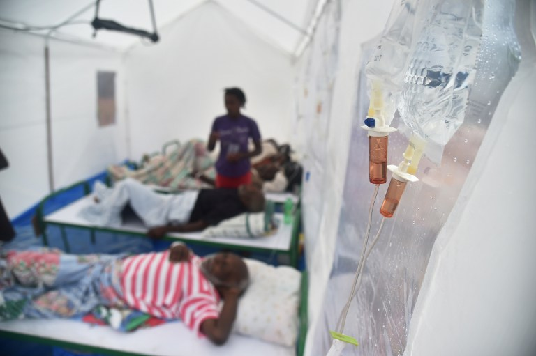 CHOLERA OUTBREAK. Patients with cholera symptoms receive medical attention in a field hospital of Samaritan's Purse in Randelle, Haiti, on October 19, 2016. Photo by Hector Retamal/AFP