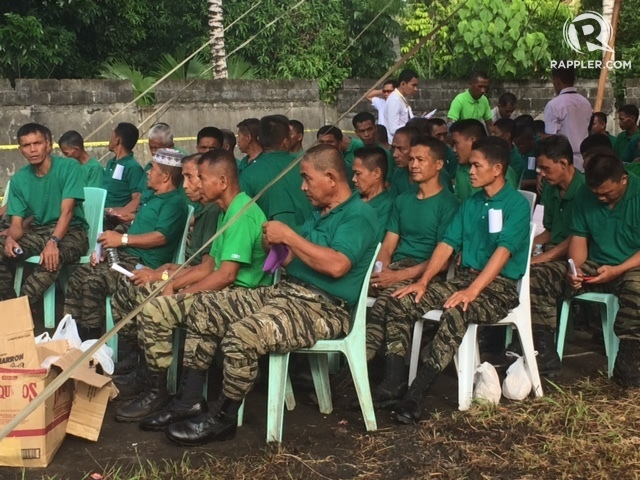 MORE THAN STATISTICS. MILF guerrillas turn over firearms to an independent body on Tuesday, June 16. Photo by Rappler