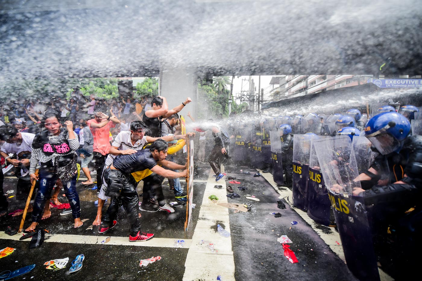REPEL. To repel protesters, police use water cannons and sonic alarm.