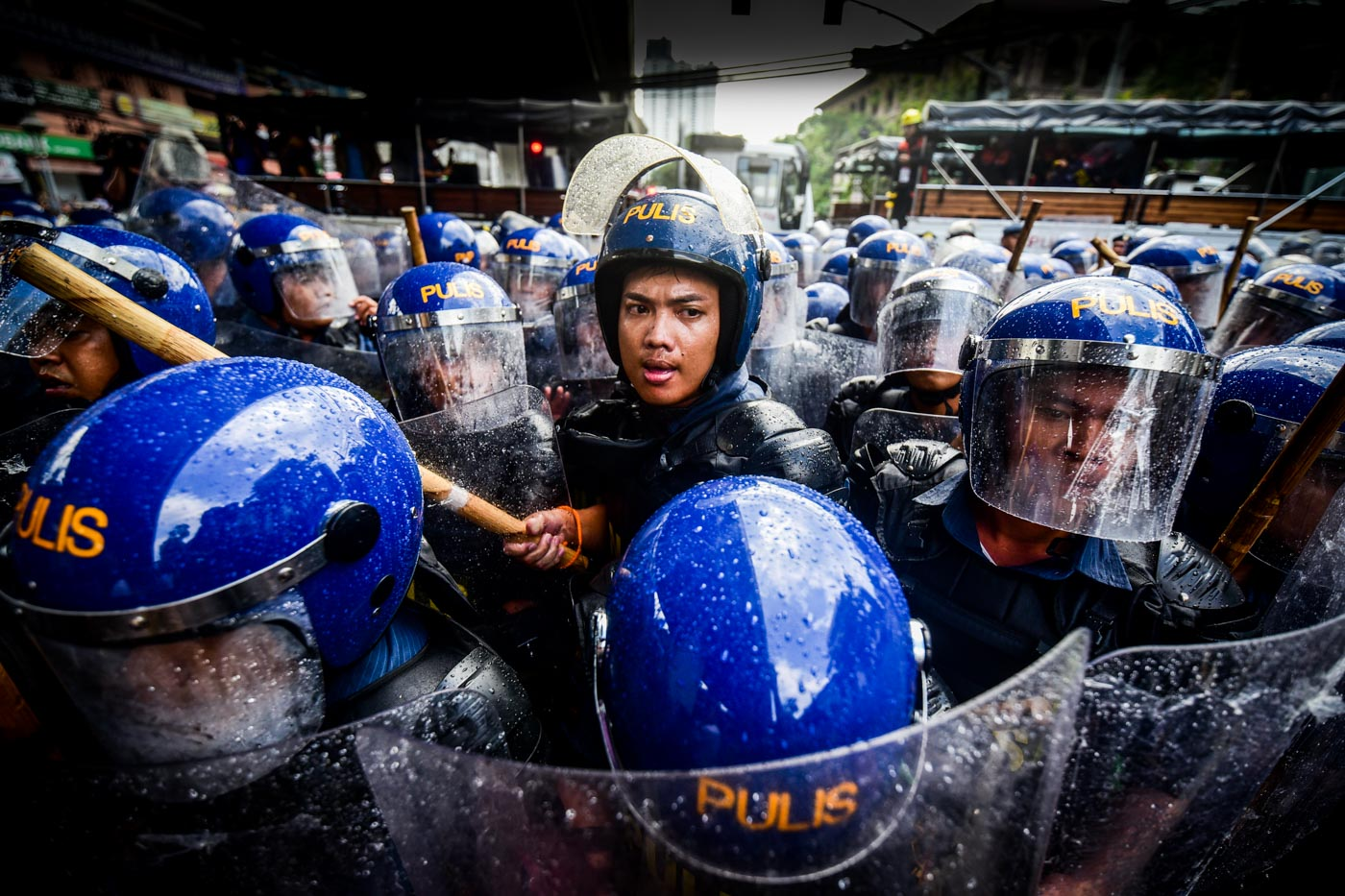 SECURITY. Around a hundred anti-riot police respond to the protest action along Taft Avenue on Monday, November 13.