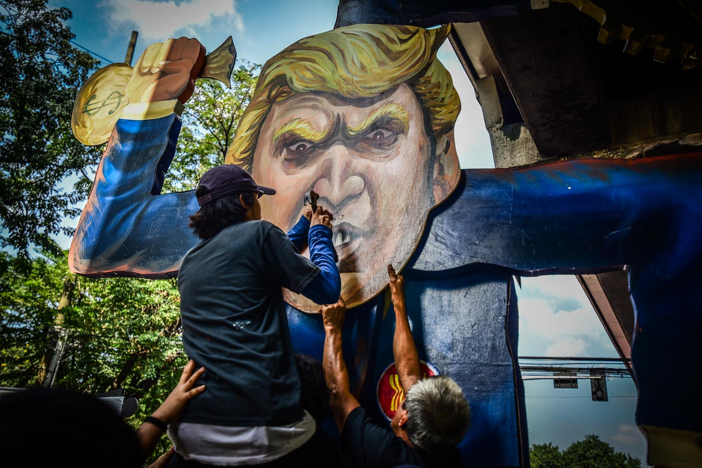 FASCIST SPINNER. Activists unveil the 'Fascist Spinner', a 13-foot tall effigy of US President Donald Trump.