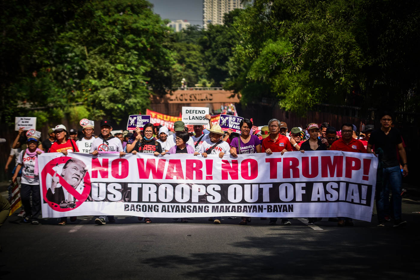 PROTESTERS. At least 1,500 protesters take the street along Taft Avenue to rally against  US President Trump's visit to the Philippines during the ASEAN Leader's Summit on November 13, 2017.  All photos by Alecs Ongcal/Rappler