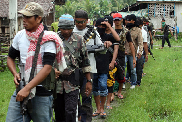 BREAKAWAY GROUP: Bangsamoro Islamic Freedom Fighters members, some of them minors, are seen inside their camp in Datu Saudi Ampatuan town Maguindanao in this picture taken on September 2012
