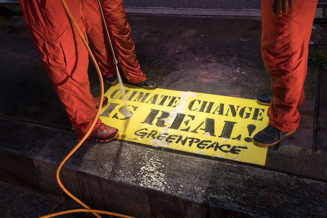 GRAFFITI PAINTING. Greenpeace activists paint reverse-graffiti in various spots around the ASEAN Summit venues