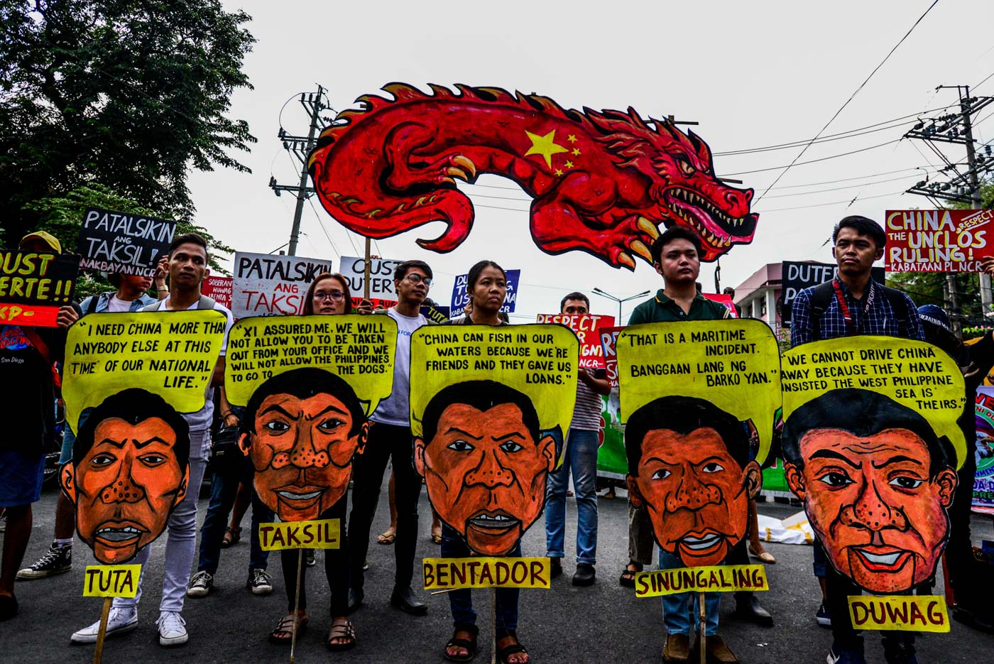 SYMBOL. Protesters hold image of a Chinese dragon and an image of President Rodrigo Duterte in a rally in Mendiola, Manila on July 12, 2019. Photo by Maria Tan/Rappler