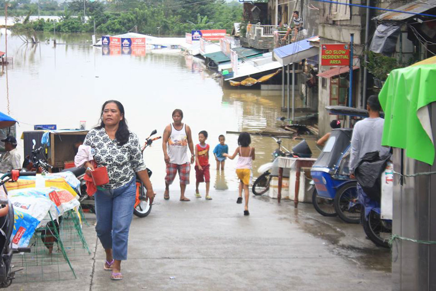 SUBMERGED. Houses in low-lying areas in Tuguegarao are flooded due to the swollen Pinacanauan River. Photo courtesy of Cagayan PIO