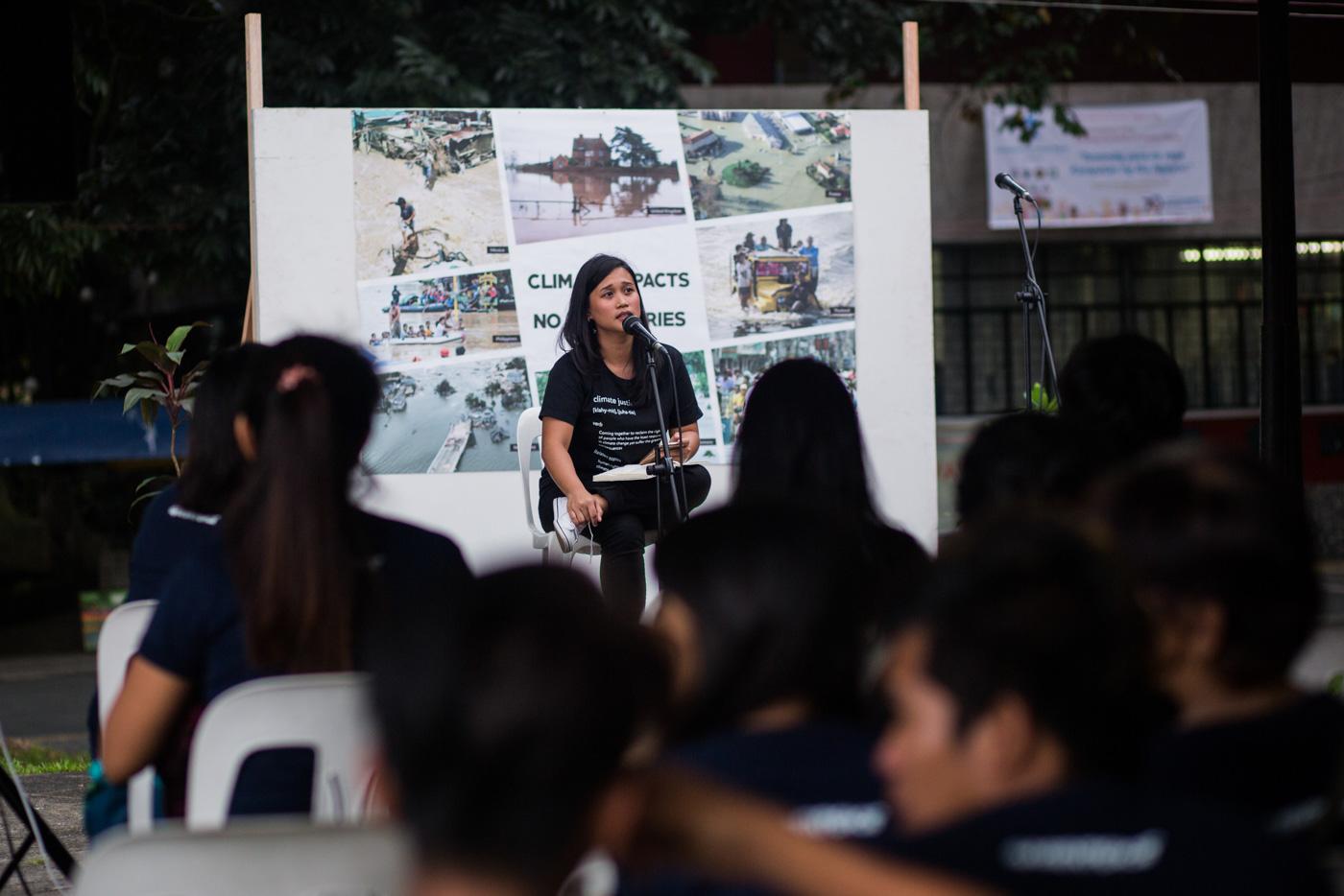 YOLANDA EXPERIENCE. Joanna Sustento shares her experience during Super Typhoon Yolanda (Haiyan) during the vigil. Photo by Geric Cruz/Greenpeace