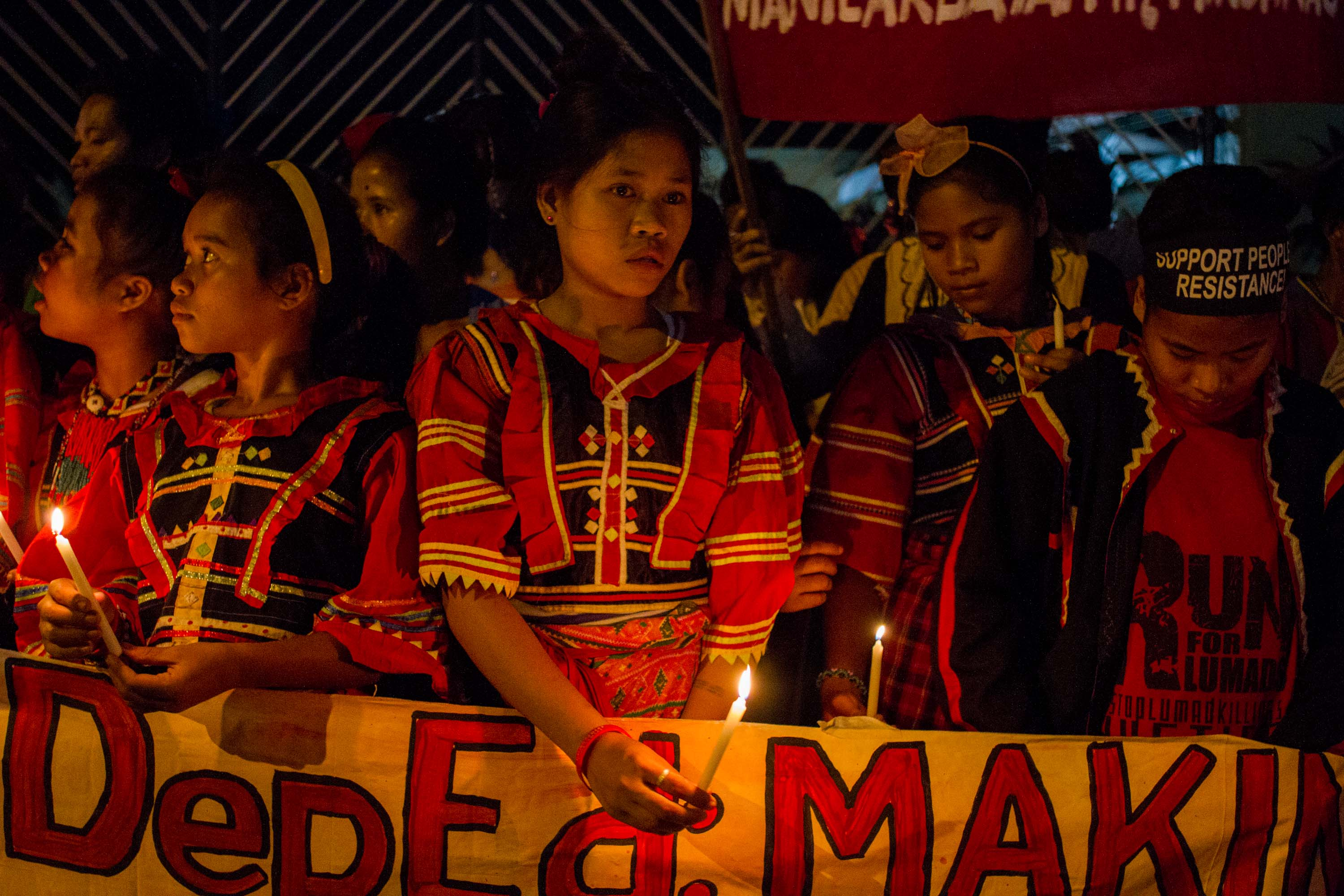 INDIGENOUS PEOPLES. Students of various tribal schools from Mindanao stage a protest rally and a candle lighting activity in front of the DEPED Main Office in Ortigas. Photo by Mark Saludes / Rappler