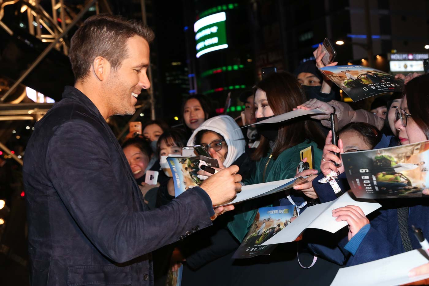 Fan service: 6 Underground star Ryan Reynolds signs autographs for fans outside the Dongdaemun Design Plaza where the Netflix movie premiered on December 02, 2019 in Seoul, South Korea. Photo courtesy of Netflix