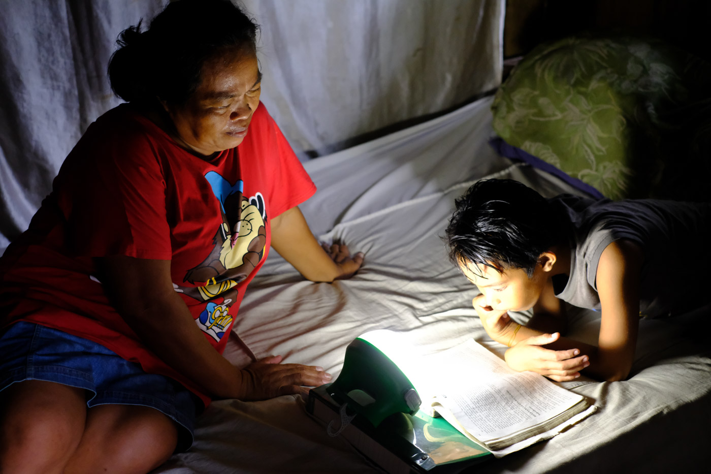 Oliva Postrado finds the solar lamp very helpful, aside from it's many uses, she can also save money supposed to be paid for electricity costs. Photo by WWF Philippines