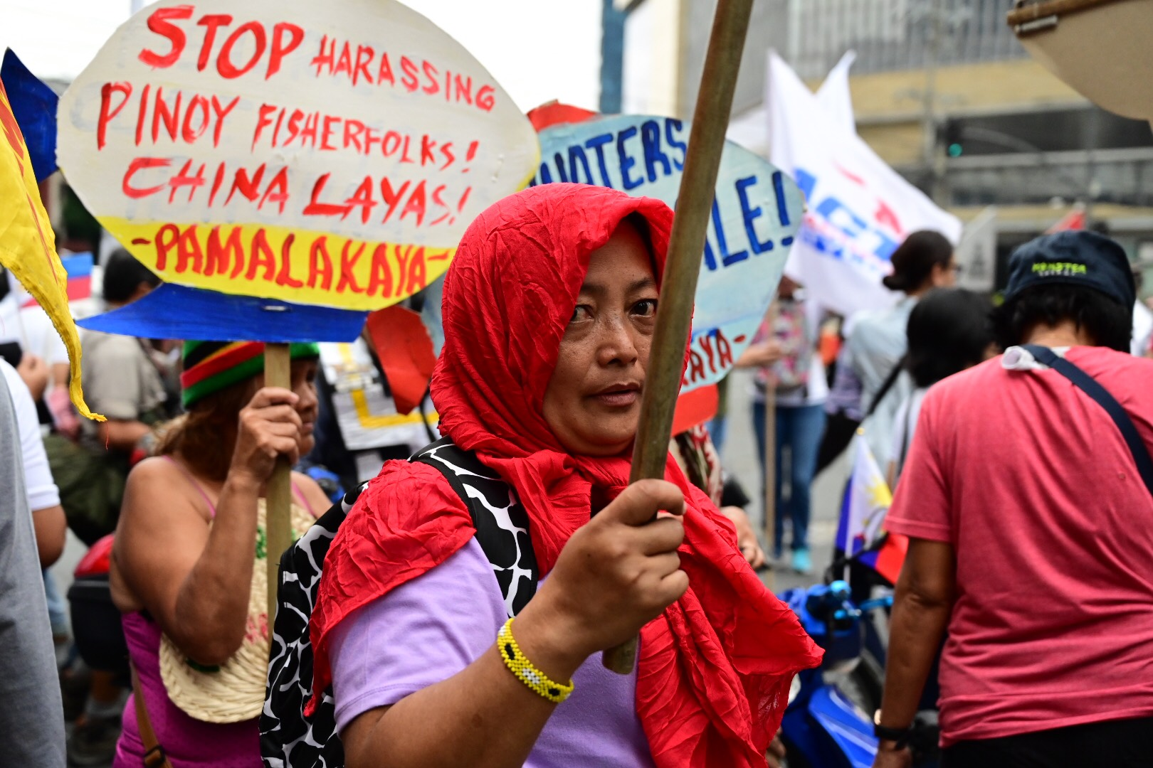 SOVEREIGNTY. Different groups march towards the Chinese Consulate in Makati to protest the presence of China in the West Philippine Sea on Tuesday, April 9, 2019. Photo by Alecs Ongcal/Rappler