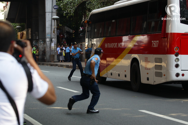 AFTERNOON CRISIS. An HM Transport bus is held hostage by a man reportedly armed with a knife  along Taft Avenue near Pedro Gil on October 8, 2015. Photo by Czeasar Dancel/Rappler