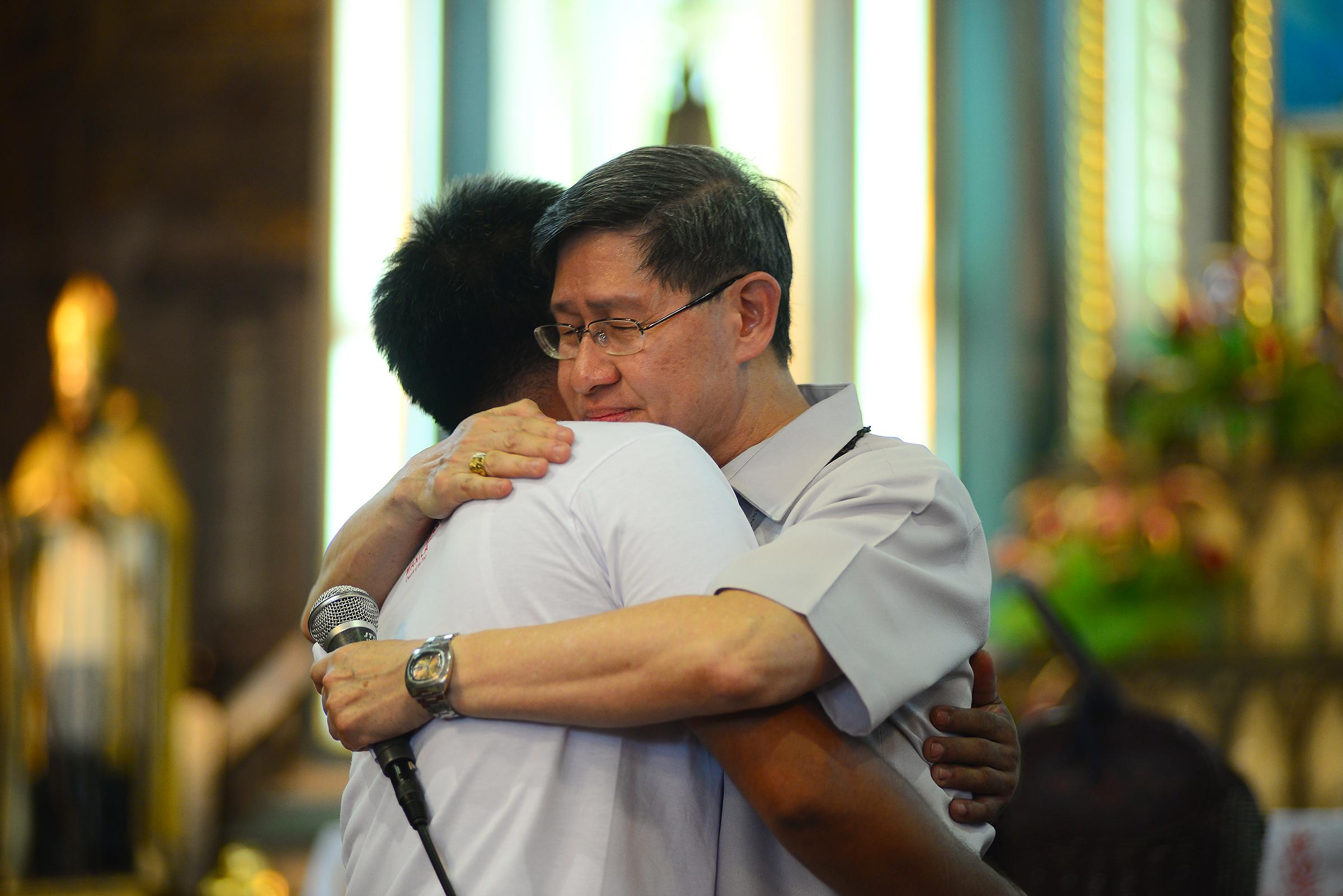 'YOU'RE NOT HOPELESS'. Cardinal Tagle hugs a Sanlakbay graduate on October 21, 2017. Photo by Maria Tan/Rappler