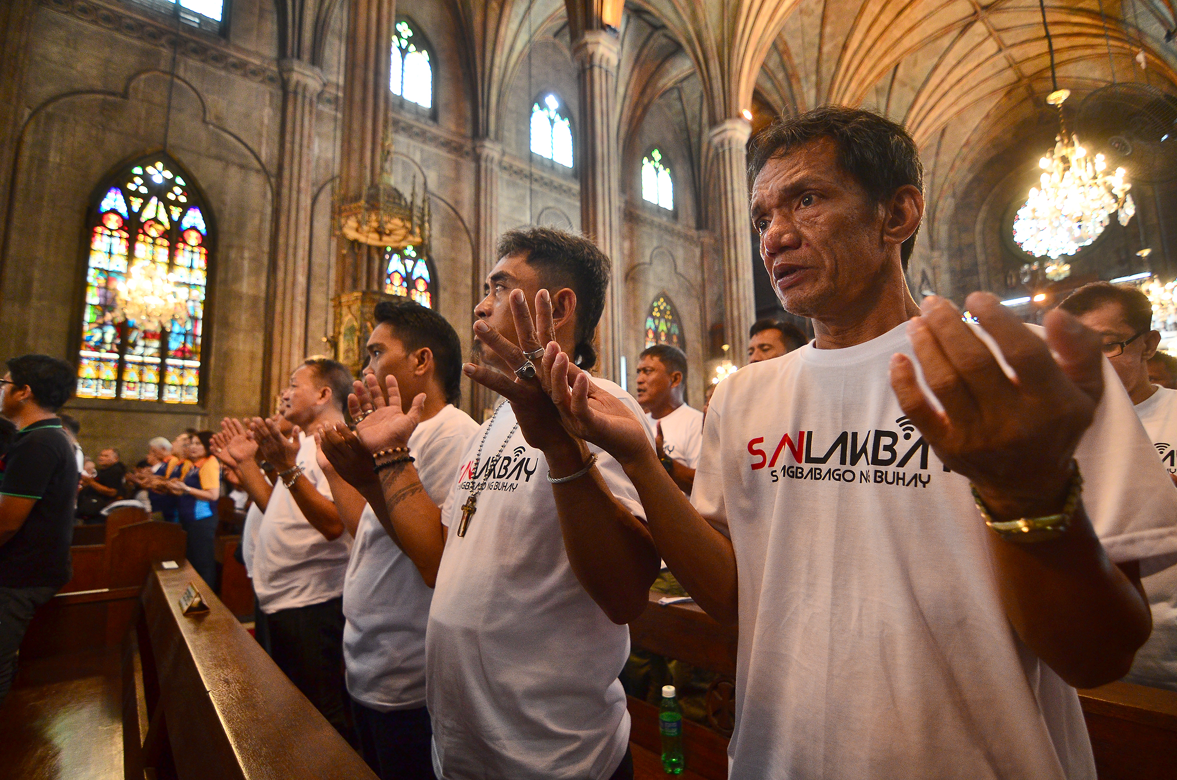 LORD'S PRAYER. Former drug dependents raise their hands as they sing the Lord's Prayer. Photo by Maria Tan