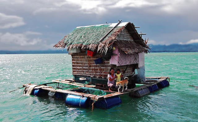 OUT AT SEA. A typical grow-out facility in Southern Palawan. Operators must feed and protect the fish, which are held in submerged cages beneath and around the central hut for around 10 months. There is no electricity. Food and water are supplied exclusively by boat. Photo by Gregg Yan / WWF