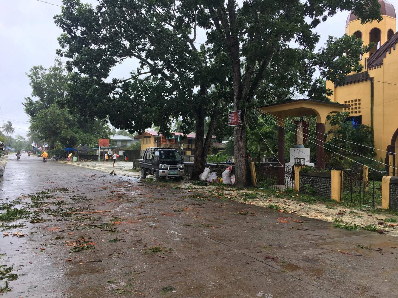AFTER AURING. Power lines on a street in Siargao Island in Surigao del Norte are down. Photo by Perry Paul Lamanilao