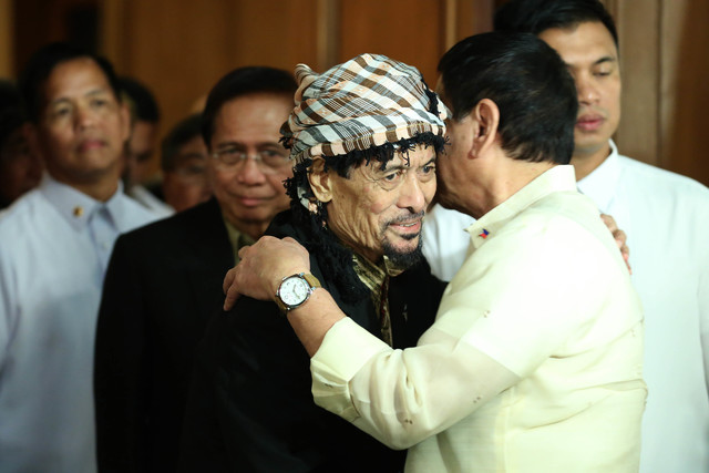 NOTHING WRONG. President Rodrigo Duterte says there is nothing wrong with 'embracing' Moro National Liberation Front leader Nur Misuari. Photo by Presidential Photo
