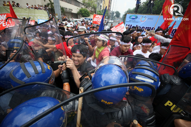 YOUTH POWER. Youth activists from the League of Filipino Students clash with anti-riot police while attempting to hold a protest near the venue of APEC in Pasay City. Photo by Ben Nabong/Rappler